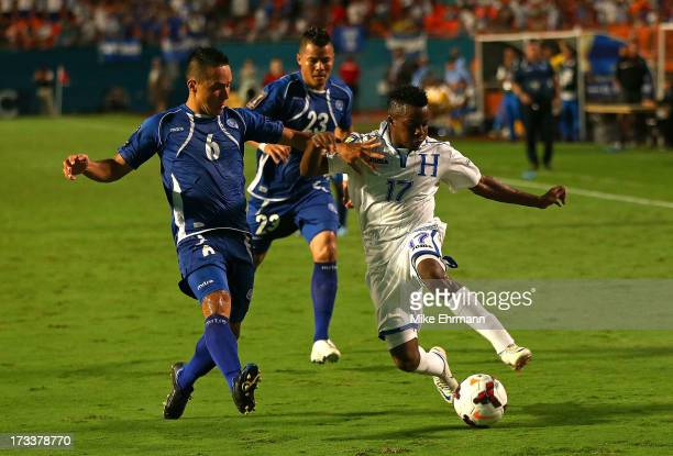 Marvin Antonio Chavez of Honduras fights for a loose ball with Richard Menjivar Peraza of EL Salvador during a CONCACAF Gold Cup game at Sun Life...