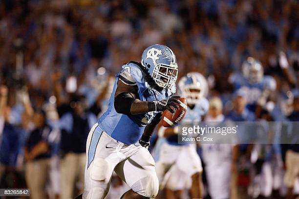 Marvin Austin of the North Carolina Tar Heels returns an interception for a touchdown during the game against the Connecticut Huskies at Kenan...