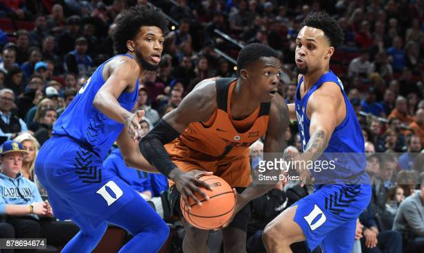 Marvin Bagley III and Gary Trent Jr of the Duke Blue Devils trap Andrew Jones of the Texas Longhorns during the first half of the game during the...