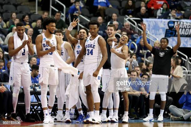 Marvin Bagley III and Wendell Carter Jr of the Duke Blue Devils react from the bench against the Rhode Island Rams during the second half in the...