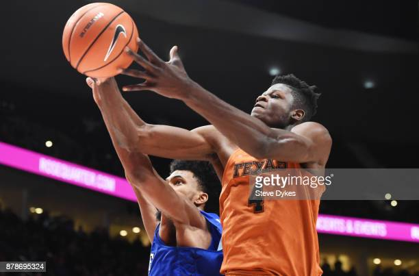 Marvin Bagley III of the Duke Blue Devils and Mohamed Bamba of the Texas Longhorns go after a rebound during the second half of the game during the...