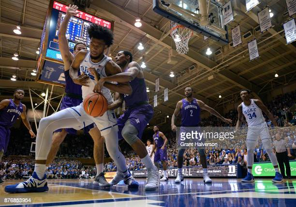 Marvin Bagley III of the Duke Blue Devils battles Andrew Brown and Daniel Fowler of the Furman Paladins for a loose ball during their game at Cameron...