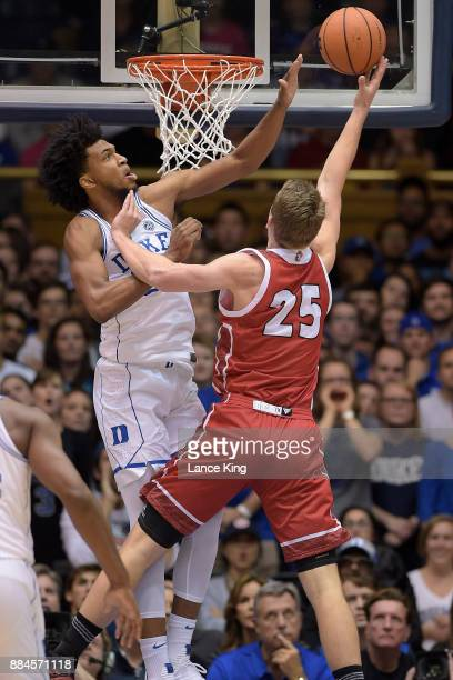 Marvin Bagley III of the Duke Blue Devils defends a shot by Tyler Hagedorn of the South Dakota Coyotes at Cameron Indoor Stadium on December 2 2017...