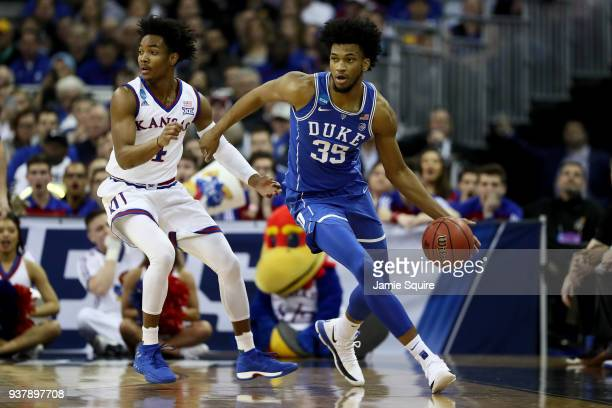 Marvin Bagley III of the Duke Blue Devils dribbles against Devonte' Graham of the Kansas Jayhawks during the first half in the 2018 NCAA Men's...