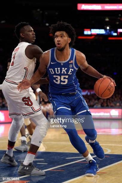 Marvin Bagley III of the Duke Blue Devils drives against Bashir Ahmed of the St John's Red Storm at Madison Square Garden on February 3 2018 in New...