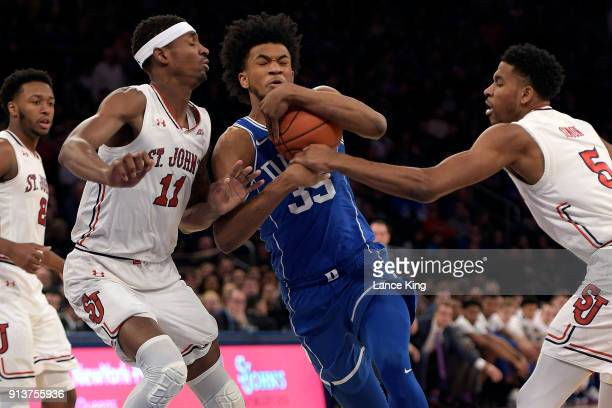 Marvin Bagley III of the Duke Blue Devils drives against Tariq Owens and Justin Simon of the St John's Red Storm at Madison Square Garden on February...