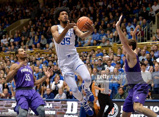 Marvin Bagley III of the Duke Blue Devils drives between Daniel Fowler and Clay Mounce of the Furman Paladins during their game at Cameron Indoor...