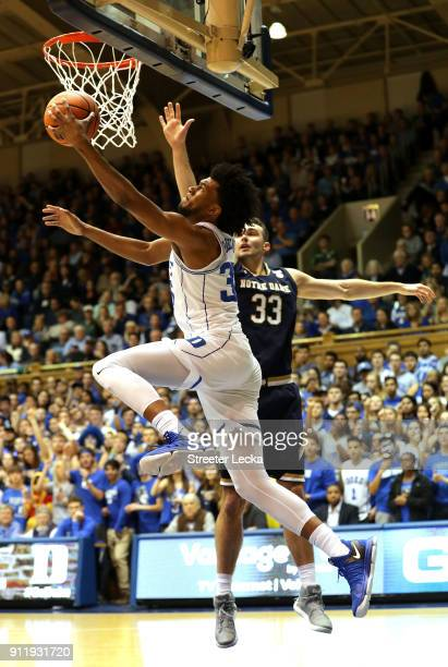 Marvin Bagley III of the Duke Blue Devils drives to the basket against John Mooney of the Notre Dame Fighting Irish during their game at Cameron...