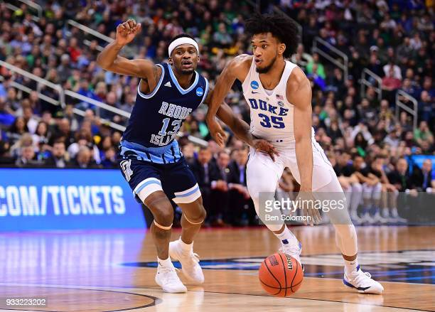 Marvin Bagley III of the Duke Blue Devils drives to the basket against Stanford Robinson of the Rhode Island Rams in the first half during the game...
