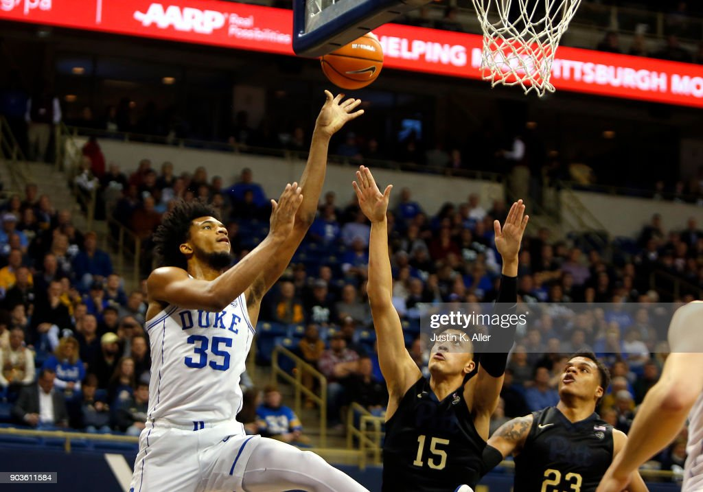 Marvin Bagley III #35 of the Duke Blue Devils drives to the rim against Shamiel Stevenson #23 and Kene Chukwuka #15 of the Pittsburgh Panthers at Petersen Events Center on January 10, 2018 in Pittsburgh, Pennsylvania.