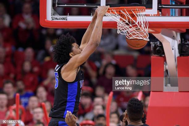 Marvin Bagley III of the Duke Blue Devils dunks the ball against the North Carolina State Wolfpack at PNC Arena on January 6, 2018 in Raleigh, North...