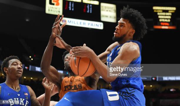 Marvin Bagley III of the Duke Blue Devils grabs a rebound in front of Mohamed Bamba of the Texas Longhorns as Wendell Carter Jr closes in during the...