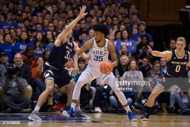 Marvin Bagley III of the Duke Blue Devils moves the ball against John Mooney of the Notre Dame Fighting Irish at Cameron Indoor Stadium on January 29...