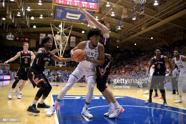 Marvin Bagley III of the Duke Blue Devils moves the ball against Deivydas Kuzavas of the St Francis Red Flash at Cameron Indoor Stadium on December 5...