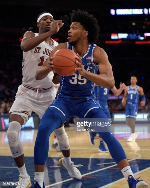 Marvin Bagley III of the Duke Blue Devils moves the ball against Tariq Owens of the St John's Red Storm at Madison Square Garden on February 3 2018...