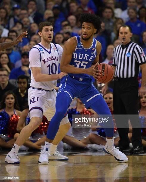 Marvin Bagley III of the Duke Blue Devils moves the ball against Sviatoslav Mykhailiuk of the Kansas Jayhawks during the 2018 NCAA Men's Basketball...