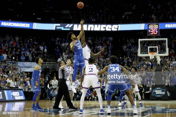 Marvin Bagley III of the Duke Blue Devils tips off against Udoka Azubuike of the Kansas Jayhawks to start the first half in the 2018 NCAA Men's...