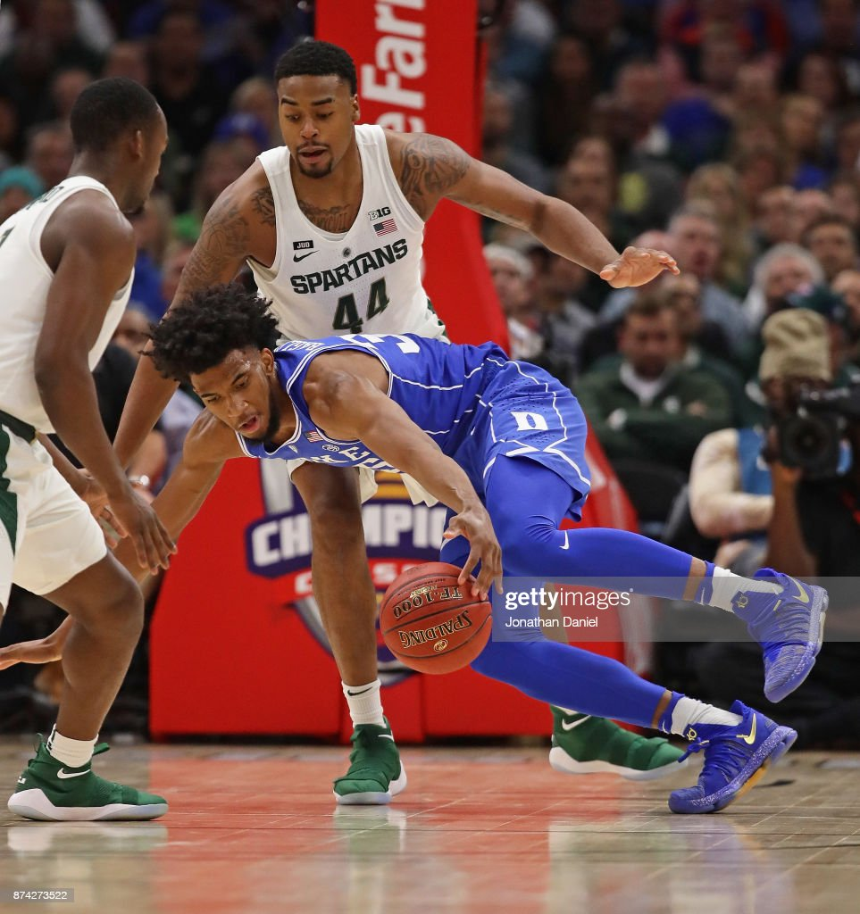 Marvin Bagley III #35 of the Duke Blue Devils tries to control the ball under pressure from Nick Ward #44 of the Michigan State Spartans during the State Farm Champions Classic at the United Center on November 14, 2017 in Chicago, Illinois.