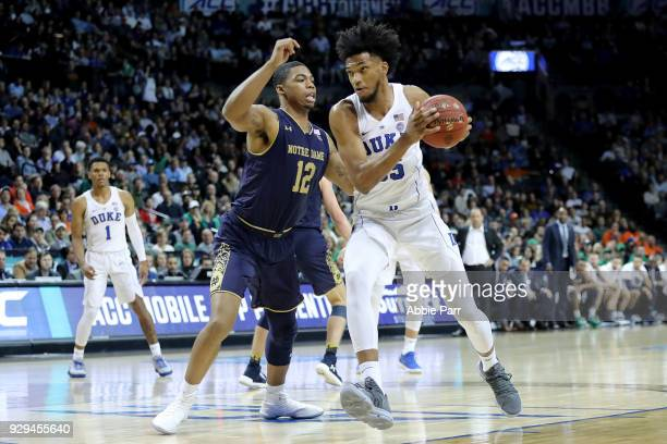 Marvin Bagley III of the Duke Blue Devils works against Elijah Burns of the Notre Dame Fighting Irish in the second half during the quarterfinals of...