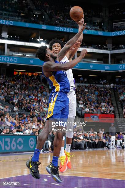 Marvin Bagley III of the Golden State Warriors shoots the ball around Jordan Bell of the Golden State Warriors on July 3 2018 at Golden 1 Center in...