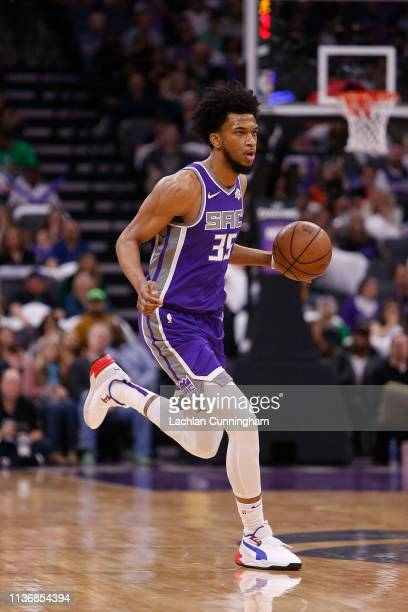 Marvin Bagley III of the Sacramento Kings dribbles the ball up court against the Chicago Bulls at Golden 1 Center on March 17, 2019 in Sacramento,...