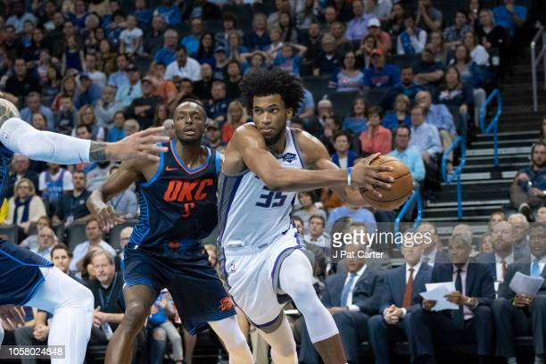 Marvin Bagley III of the Sacramento Kings drives around Oklahoma City Thunder during the second half of a NBA game at the Chesapeake Energy Arena on...