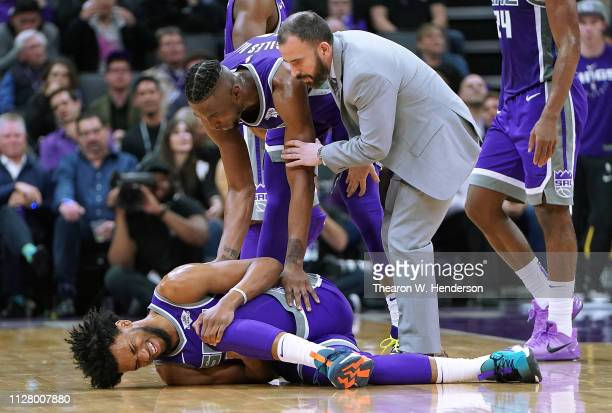 Marvin Bagley III of the Sacramento Kings falls to the floor holding his left knee after getting hurt against the Milwaukee Bucks during the second...