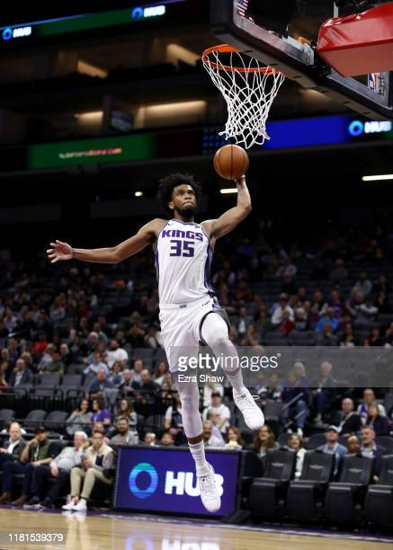 Marvin Bagley III of the Sacramento Kings goes up for a dunk against the Melbourne United at Golden 1 Center on October 16, 2019 in Sacramento,...