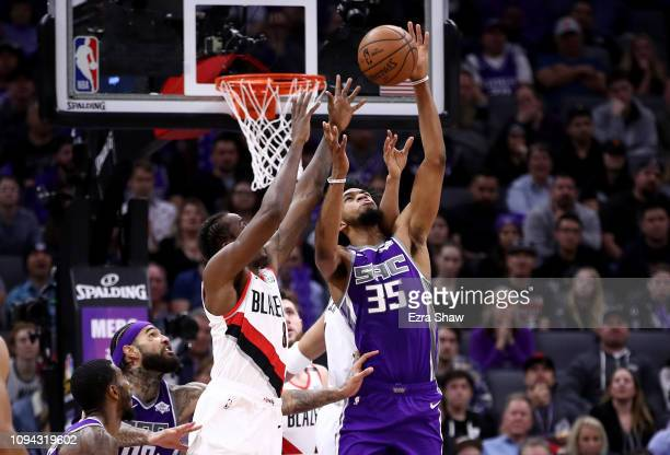 Marvin Bagley III of the Sacramento Kings goes up for a rebound against AlFarouq Aminu of the Portland Trail Blazers at Golden 1 Center on January 14...