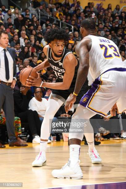 Marvin Bagley III of the Sacramento Kings handles the ball during the game against LeBron James of the Los Angeles Lakers on March 24 2019 at STAPLES...