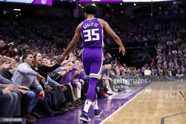 Marvin Bagley III of the Sacramento Kings high-fives fans after he made a basket against the Portland Trail Blazers at Golden 1 Center on January 14,...