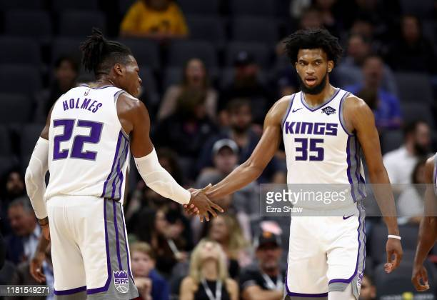 Marvin Bagley III of the Sacramento Kings is congratulated by Richaun Holmes after he scored against the Melbourne United at Golden 1 Center on...
