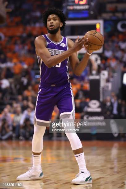 Marvin Bagley III of the Sacramento Kings looks to pass during the first half of the NBA game at Talking Stick Resort Arena on October 23, 2019 in...