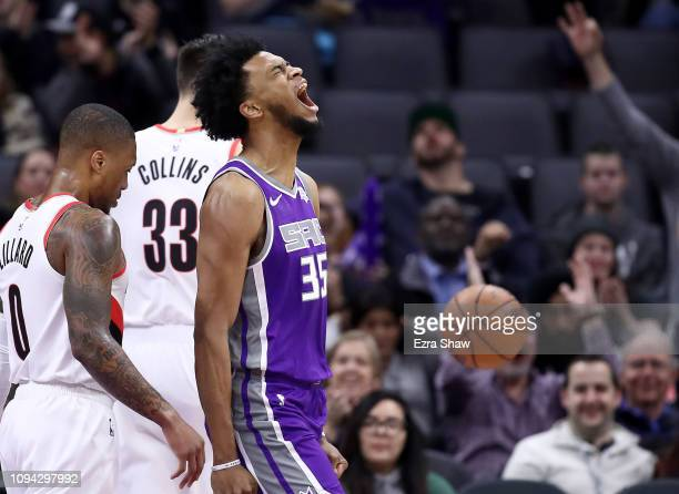 Marvin Bagley III of the Sacramento Kings reacts after dunking the ball against the Portland Trail Blazers at Golden 1 Center on January 14, 2019 in...