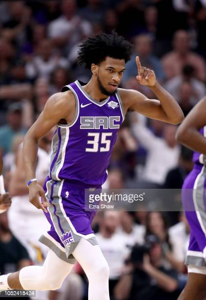 Marvin Bagley III of the Sacramento Kings reacts after he made his first NBA basket against the Utah Jazz at Golden 1 Center on October 17 2018 in...