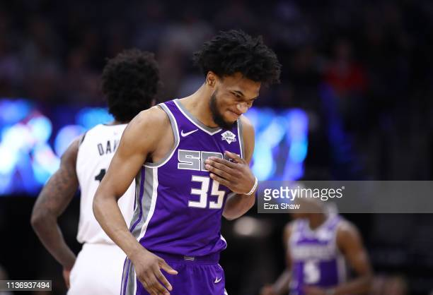 Marvin Bagley III of the Sacramento Kings reacts after making a basket against the Brooklyn Nets at Golden 1 Center on March 19, 2019 in Sacramento,...
