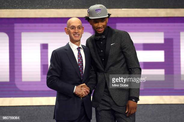 Marvin Bagley III poses with NBA Commissioner Adam Silver after being drafted second overall by the Sacramento Kings during the 2018 NBA Draft at the...