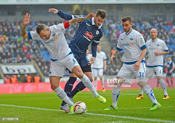 Marvin Bakalorz and Robin Krausse of Paderborn tackle Christopher Noethe of Bielefeld during the Second Bundesliga match between Arminia Bielefeld...