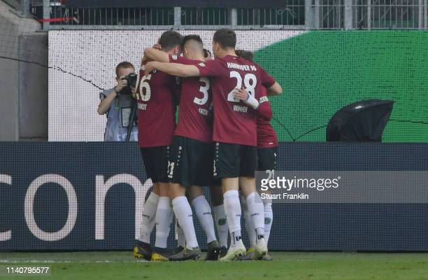 Marvin Bakalorz of Hannover 96 celebrates after scoring his team's first goal with his team mates during the Bundesliga match between VfL Wolfsburg...