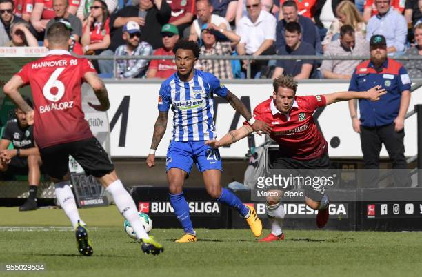 Marvin Bakalorz of Hannover 96 Valentino Lazaro of Hertha BSC and Oliver Sorg of Hannover 96 during the Bundesliga game between Hannover 96 and...