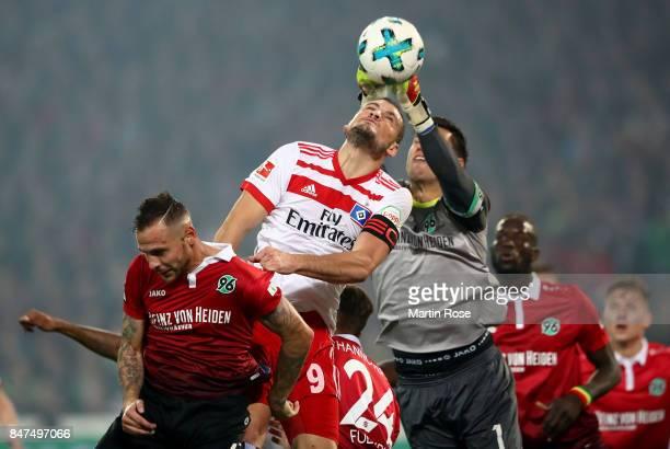 Marvin Bakalorz of Hannover and Kyriakos Papadopoulos of Hamburg head for the ball during the Bundesliga match between Hannover 96 and Hamburger SV...