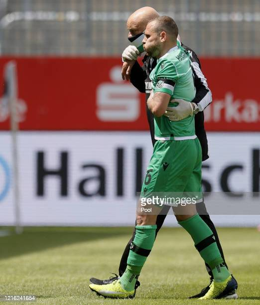 Marvin Bakalorz of Hannover receives medical assistance during the Second Bundesliga match between SV Sandhausen and Hannover 96 at BWTStadion am...