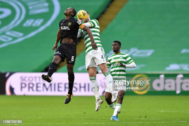 Marvin Bartley of Livingston FC and Shane Duffy of Celtic contest a header during the Ladbrokes Scottish Premiership match between Celtic and...