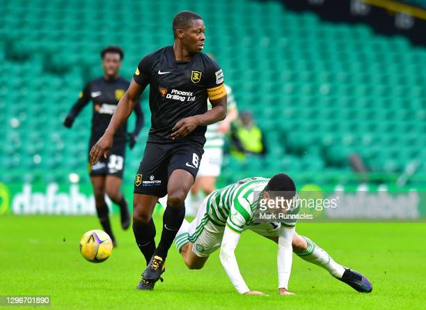 Marvin Bartley of Livingston FC and Tom Rogic of Celtic battle for possession during the Ladbrokes Scottish Premiership match between Celtic and...
