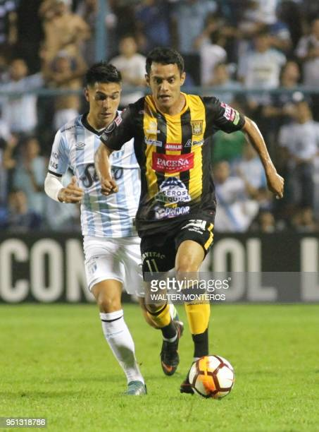 Marvin Bejarano of Bolivia's The Strongest vies for the ball with Favio Alvarez of Atletico Tucuman during their Copa Libertadores 2018 football...
