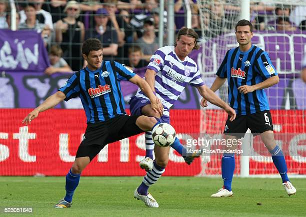 Marvin Braun of Osnabrueck and Enis Alushi of Paderborn compete for the ball during the Second Bundesliga Play Off match between VfL Osnabrueck and...