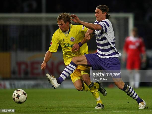 Marvin Braun of Osnabrueck and Kevin Schoeneberg of Rostock battle for the ball during the Second Bundesliga match between VfL Osnabrueck and Hansa...