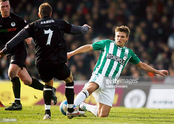 Marvin Braun of Pauli competes with Artur Schefer of Luebeck during the Third League match between FC St.Pauli and VFB Luebeck at the Millerntor...