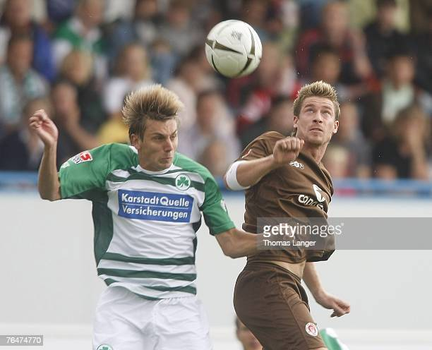 Marvin Braun of St Pauli and Timo Achenach of Fuerth battle for the ball during the 2. Bundesliga match between SpVgg Greuther Fuerth and FC St....