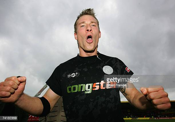 Marvin Braun of St. Pauli celebrate promotion at the end of the Third League Northern Division match between FC St.Pauli and Fortuna Dusseldorf at...